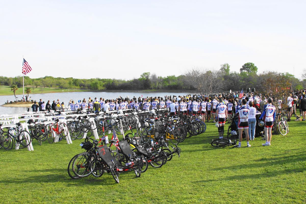 Bicyclists Stand for the American Flag Display