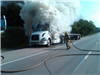 Firefighter Putting Out Semi Truck Fire