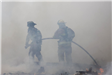 Firefighters Holding Hose Standing in Smoke