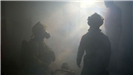 Firefighters Inside Smokey Room During Training