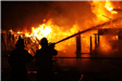 Firefighters Work to Extinguish Large Structure Fire
