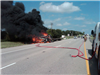 Pickup With Trailer on Fire With Dark Black Smoke Cloud