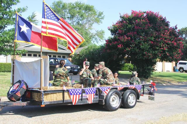 Members of the Military Ride in Parade Float